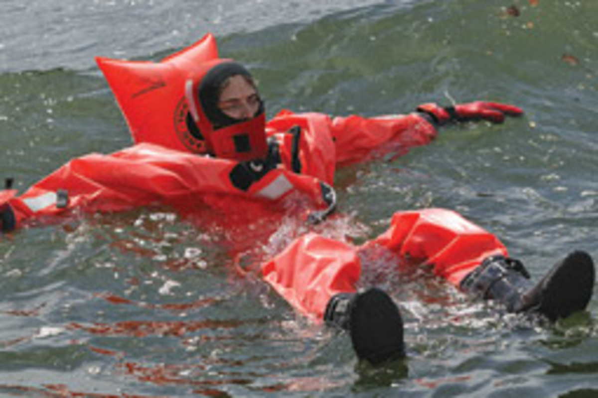An immersion suit provides floatation and keeps the wearer dry.