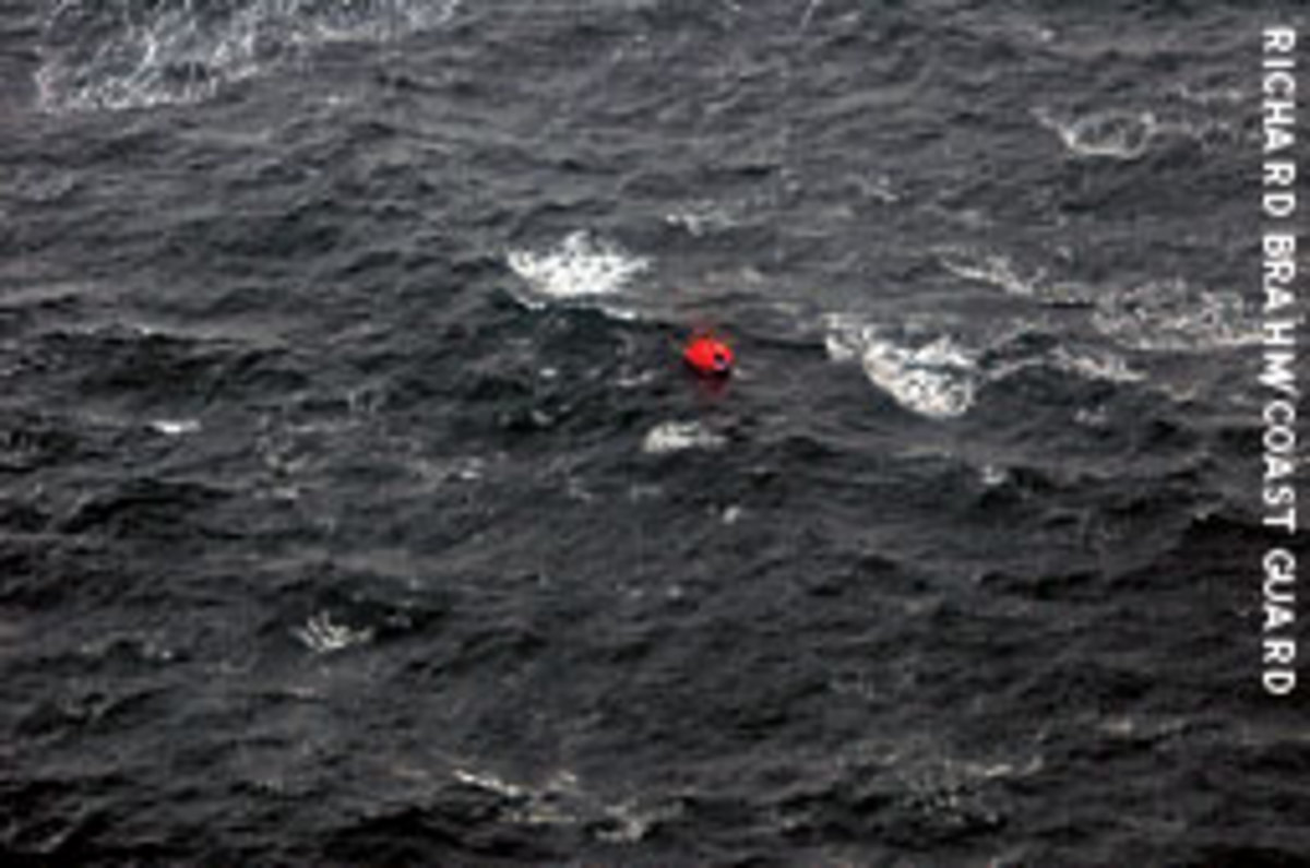 The crew of an Alaskan fishing vessel await rescue in a life raft adrift in the Bering Sea.