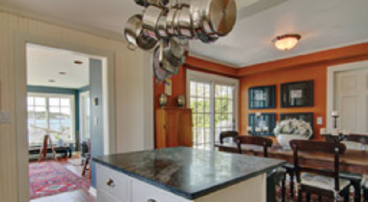 A granite-topped island separates the diining room from the kitchen.