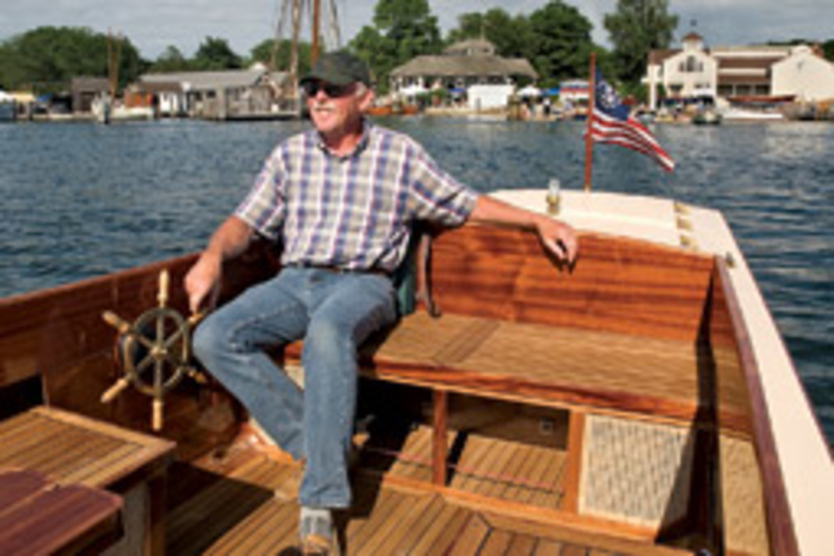 Dennis Wolfe takes a leisurely - and very quiet - cruise along the waterfront in his Harmony 25 electric launch, which was awarded best in show for innovation.