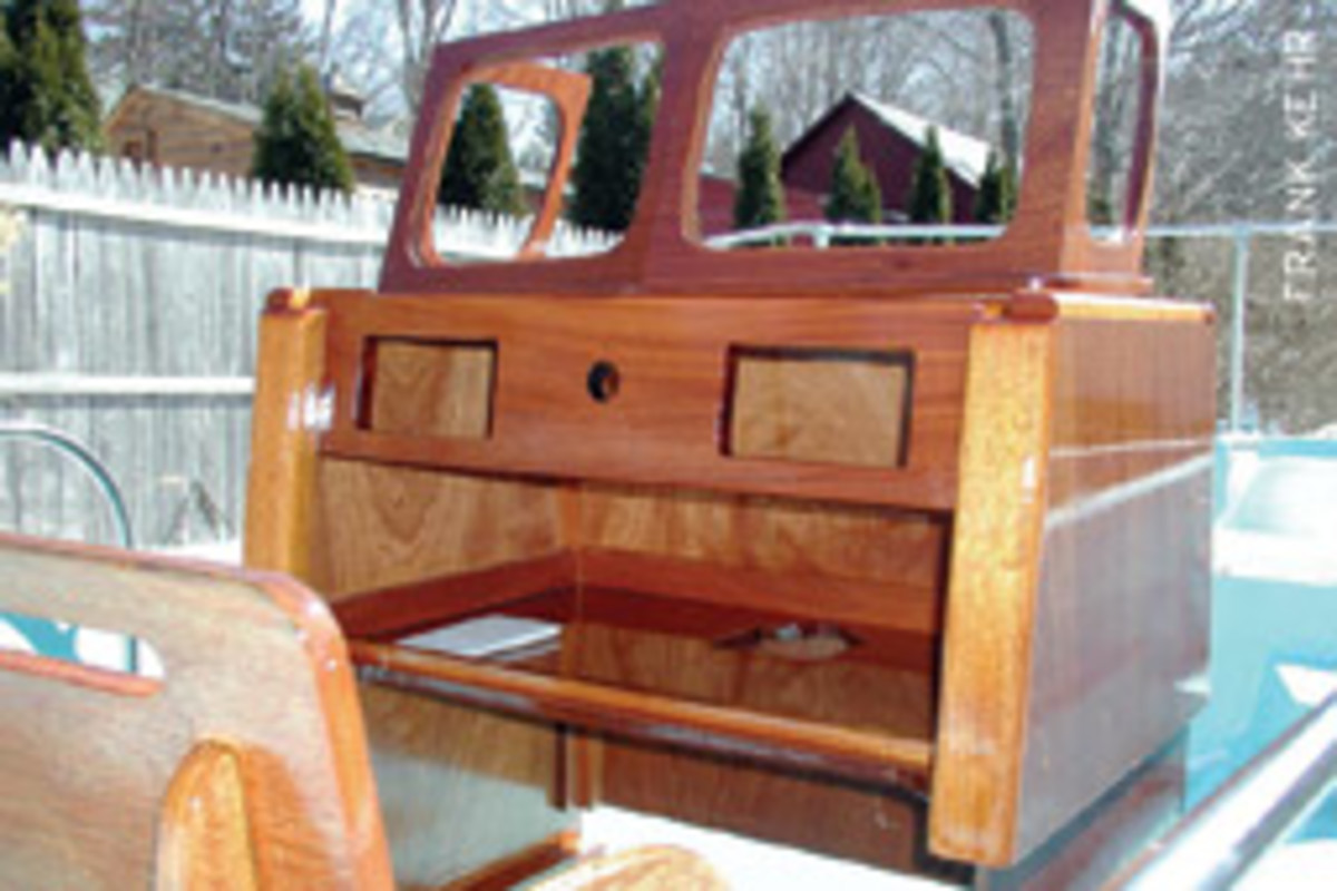 A new mahogany console was fabricated to match the one it replaced on this 1968 Boston Whaler Nauset. After many coats of varnish, it is ready for the installation of switches, wiring, controls and electronics.