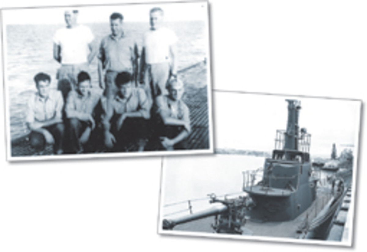 Seven of the eight survivors of the Flier (right) on the deck of the submarine Redfin soon after their rescue. One crewman was absent due to an illness.