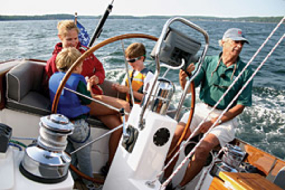 Morris takes his grandsons, Thomas (left) and Sam, and daughter-in-law Cindy for a summer cruise.