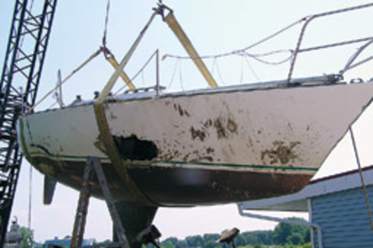 Swept away by flooding in Ohio, this J/34 didn't look bad sitting on the beach, but the starboard side had been pounded on rocks. The keel later fell off.