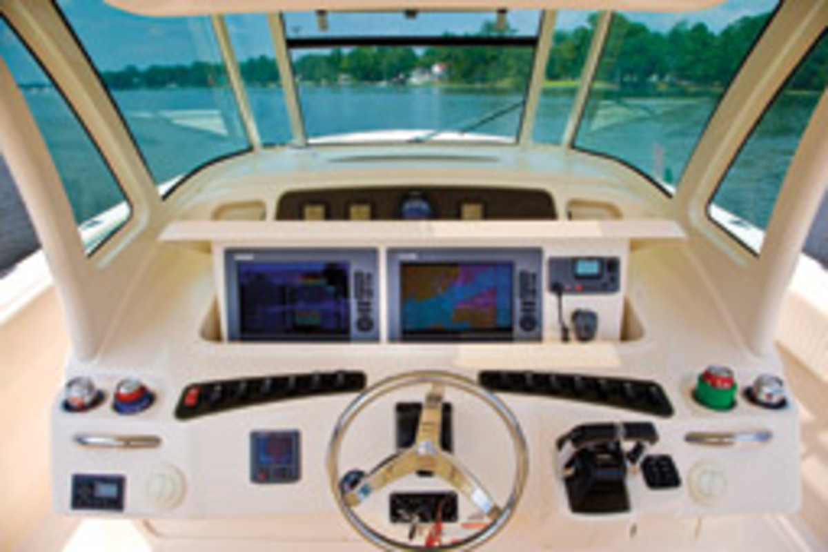 This boat's multifunction displays and VHF are mounted on an electric-powered panel that lowers to become flush with the helm surfaces.