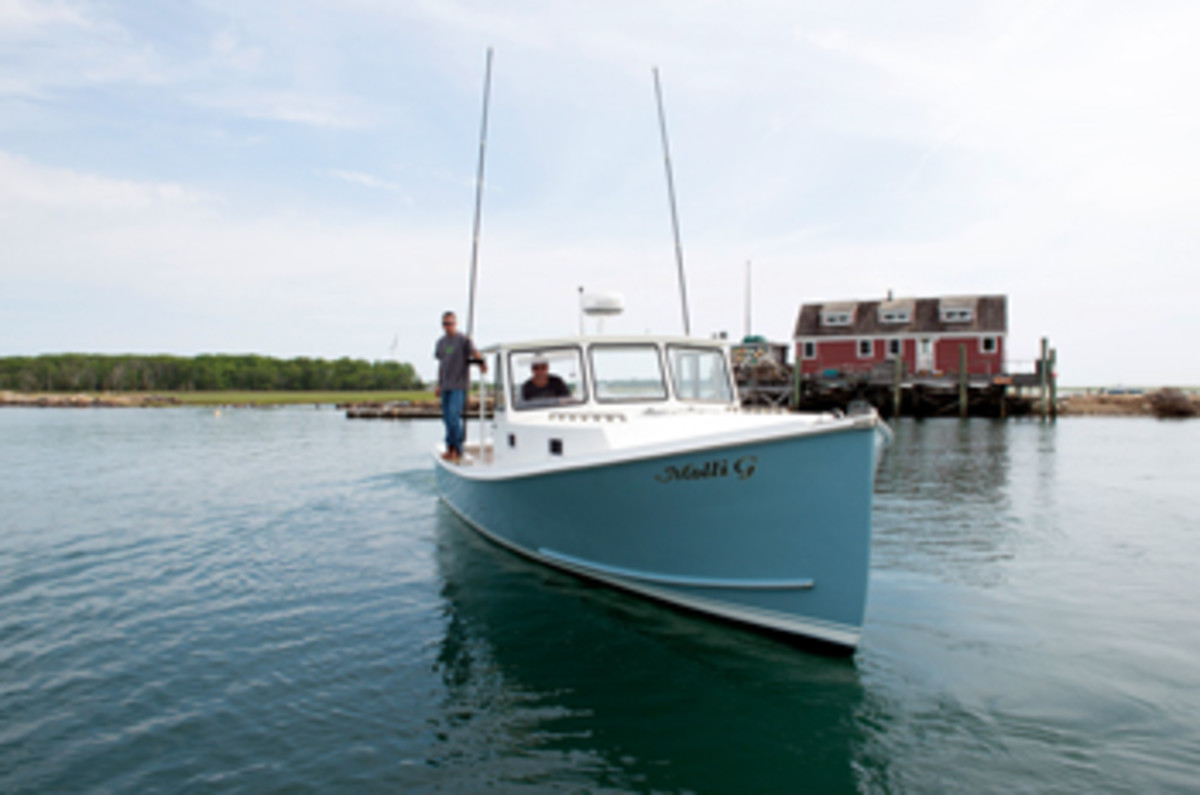 Dave Browne (at the helm) wanted Jeff Perette (on the gunwale) to refit his Calvin Beal to maintain her simple beauty and superb function. A boost in power and a very pretty finish have made Molli G a dream Down Easter.