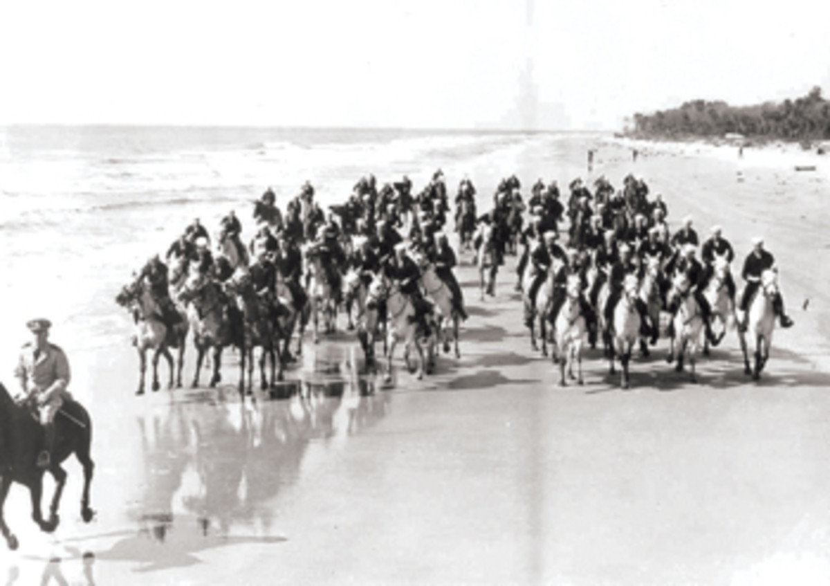 A World War II mounted Coast Guard beach patrol runs drills at Hilton Head, South Carolina.