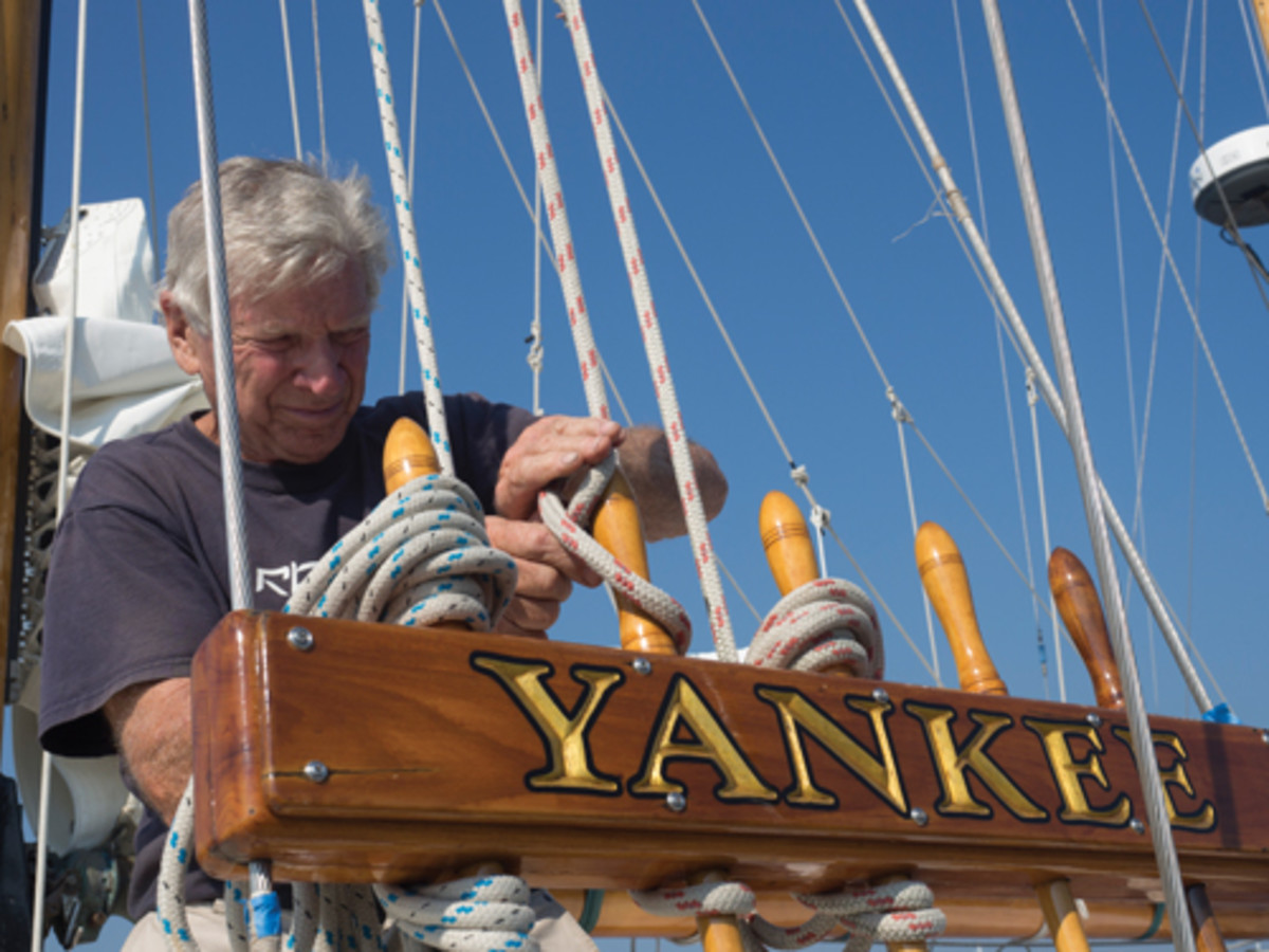 Van Nes tends Yankee's halyards at the docks of the Connecticut River Museum. Photo by Dieter Loibner.