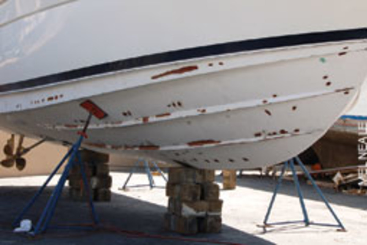 The hull of a newer boat showing voids, blisters and weak spots being repaired.