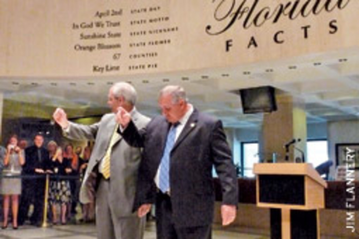 House Sergeant-at-Arms Earnest Sumner, left, and Sentate Sergeant-at-Arms Donald Severance, right, drop the traditional hankies signaling 'sine die' ending the 2009 legislature May 8.