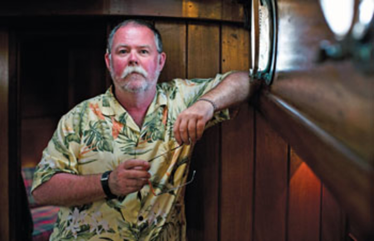 Skipper Tom Bean enjoys his yacht's mahogany-clad saloon.