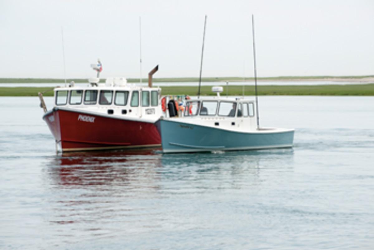 Molli G's workboat heritage is clear as she idles alongside working big sister Phoenix, near Damon Point in Marshfield, Massachusetts.
