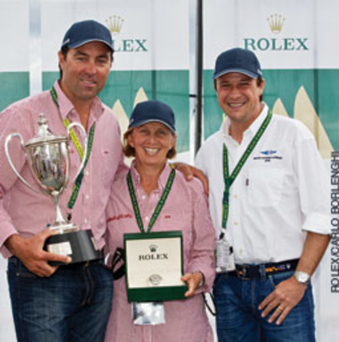 Line honors went to Wild Oats XI - (from left) skipper Mark Richards, co-navigator Adrienne Cahalan and Patrick Boutellier of Rolex Australia.