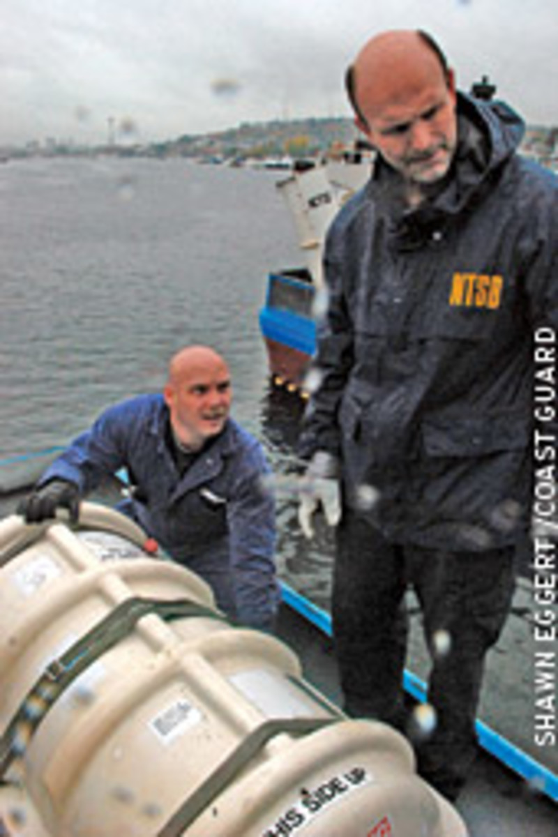 McLellan, with National Transportation Safety Board investigator Jon Furukawa, inspects below deck aboard the Miss Amy, a fishing vessel that's similar in design to Katmai.