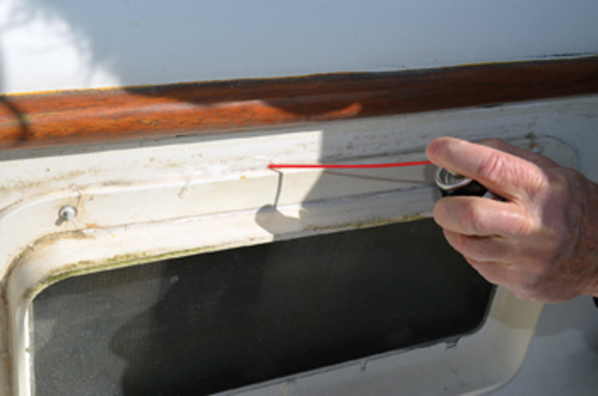 3M 5200 holds like there's no tomorrow, but with an application of DeBond and some assistance from putty knives, Tom was able to remove the ring around a portlight — without explosives or expletives.