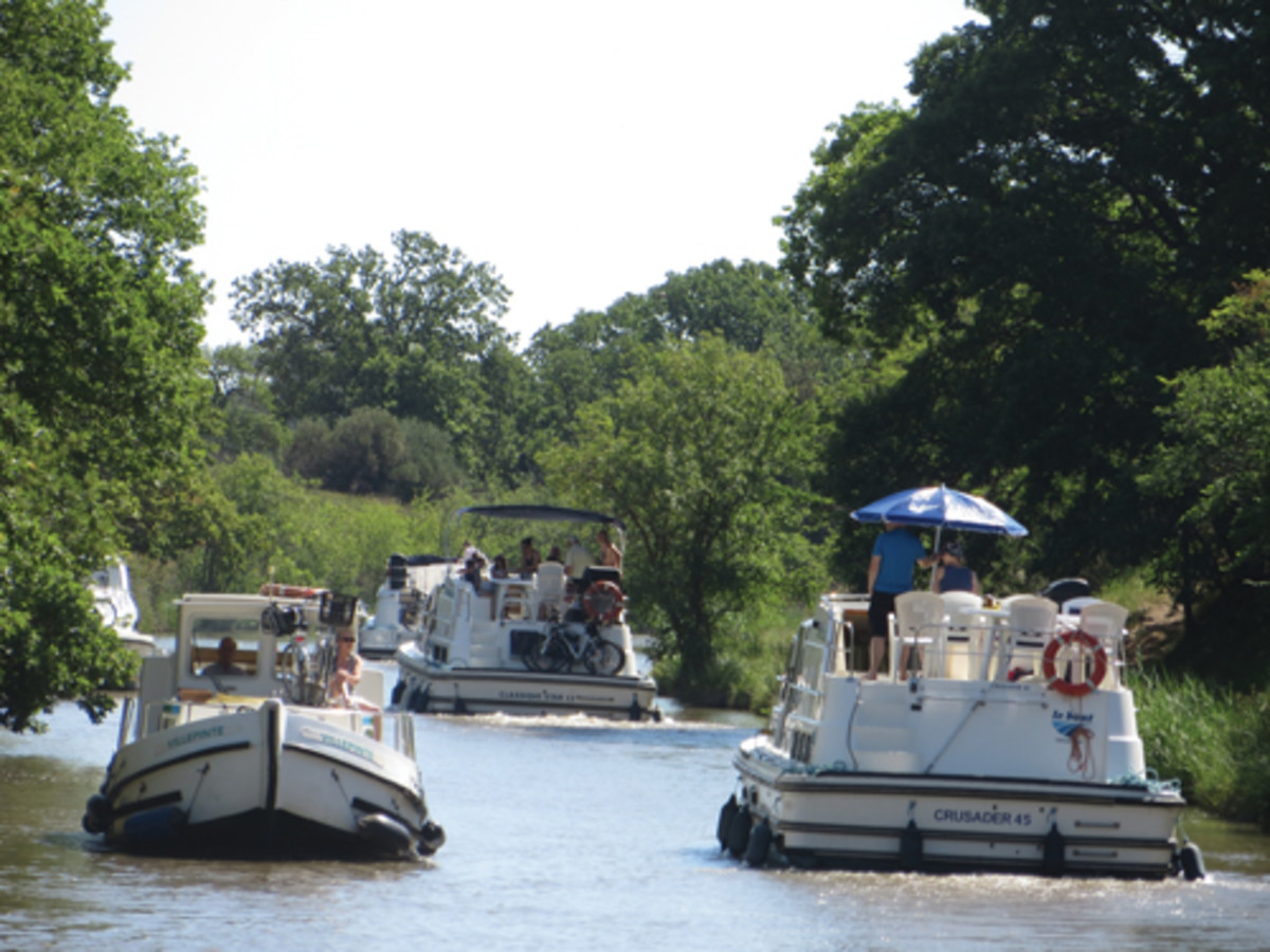 The canal can be busy and the authors were grateful that they are experienced boaters.