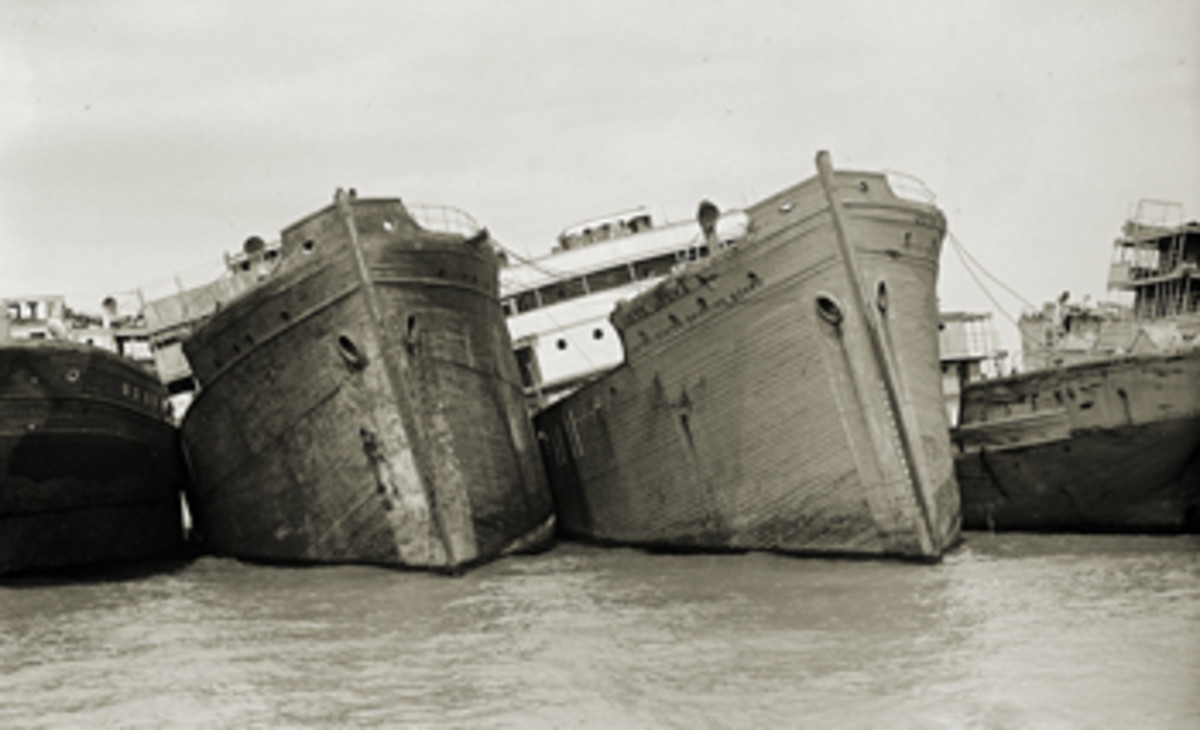 World War I-era steamships lie strapped together before being burned in 1925. Around 80 of the steamships, along with many other vessels, remain in what is the Western Hemisphere's largest maritime burial ground.