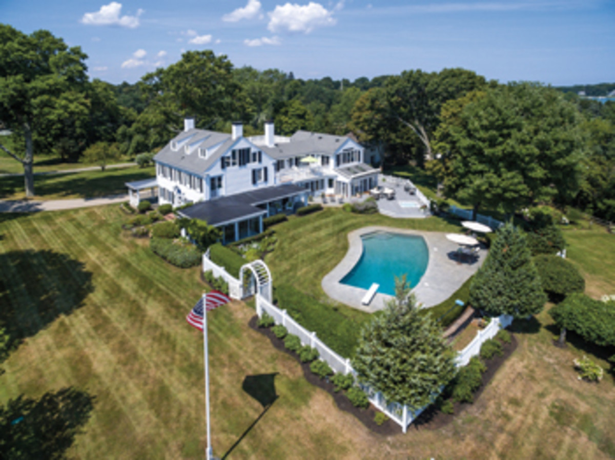 This 6,600-square-foot home on Duxbury Harbor includes an inground pool.