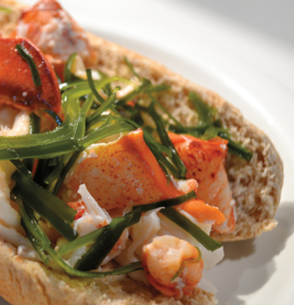 What could be more Maine than a lobster roll? One topped with locally grown sea vegetables.