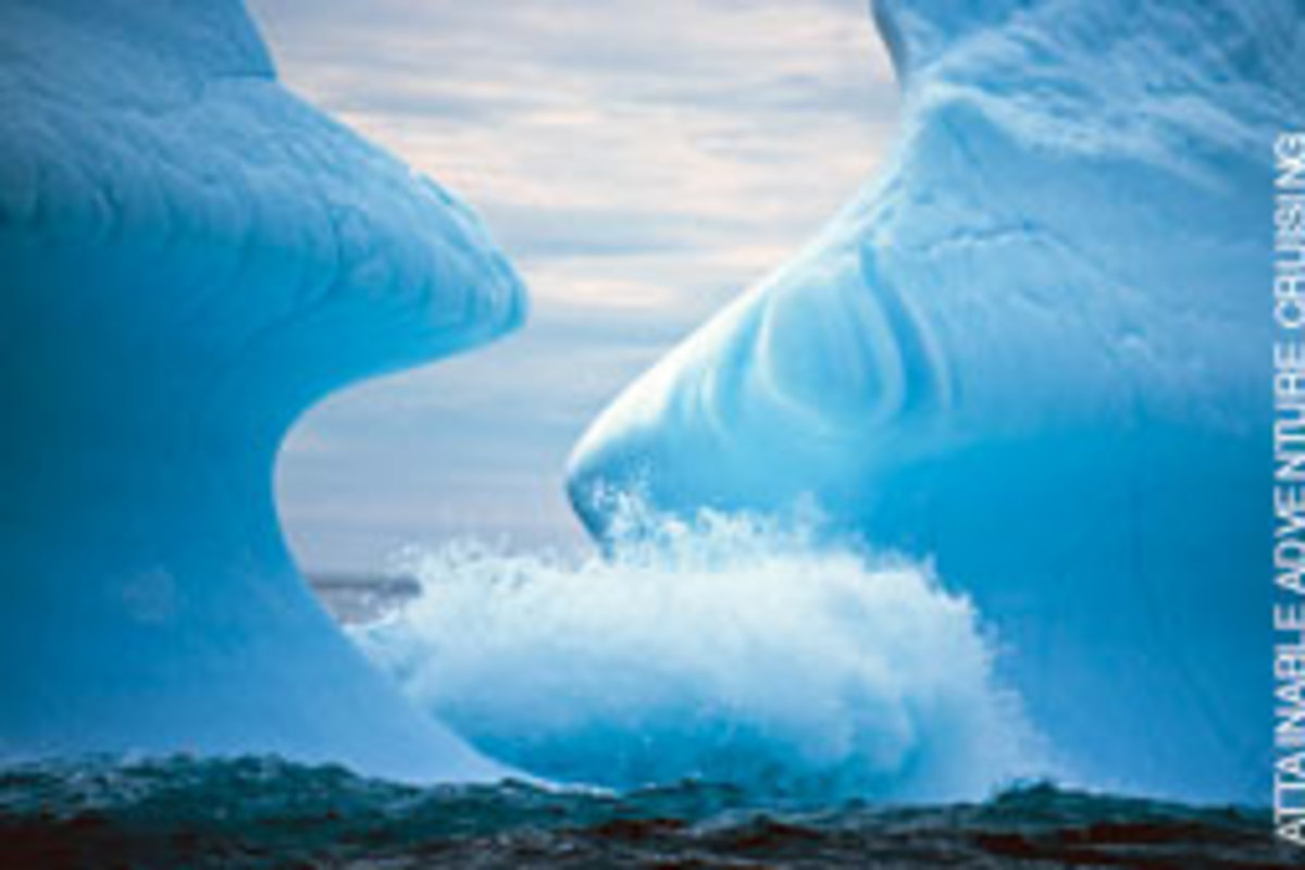 Waves have carved this iceberg on the southeast coast of Greenland into beautiful sinuous shapes.