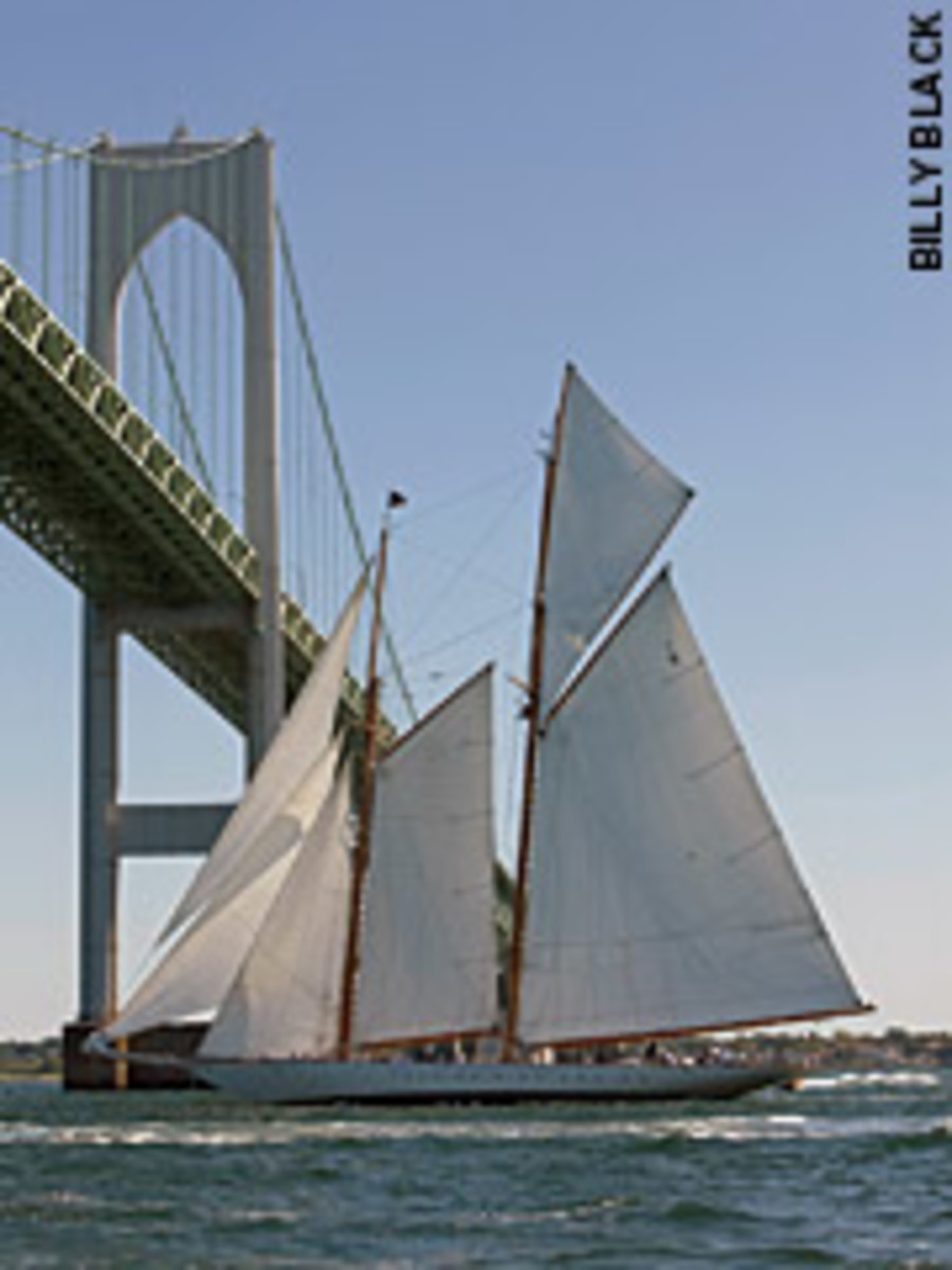 The schooner Eleonora sails under the Newport Bridge at the Best Life Classic Yacht Regatta held in late August. Venerable designer and sailor Ted Hood helmed his newly restored yacht Robin to the top of the fleet.