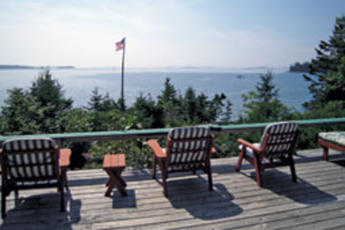 The cabin's expansive deck has sweeping views of island-dotted Penobscott Bay.