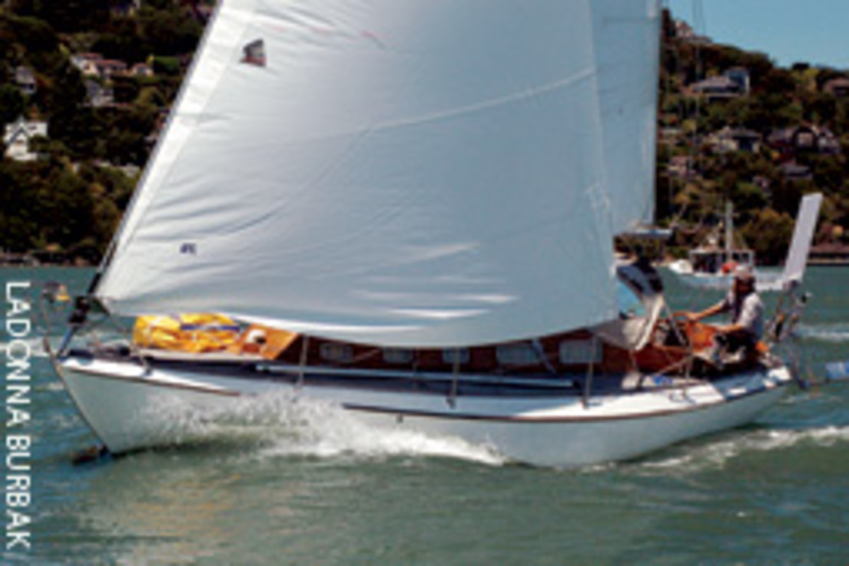Derk Wolmuth at the helm of Bela Bartok during the San Francisco Bay start of the Singlehanded TransPacific Yacht Race