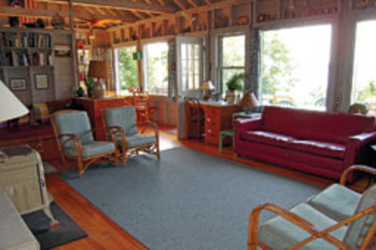 Windows in the cabin's living room provide southerly views of Penobscot Bay.