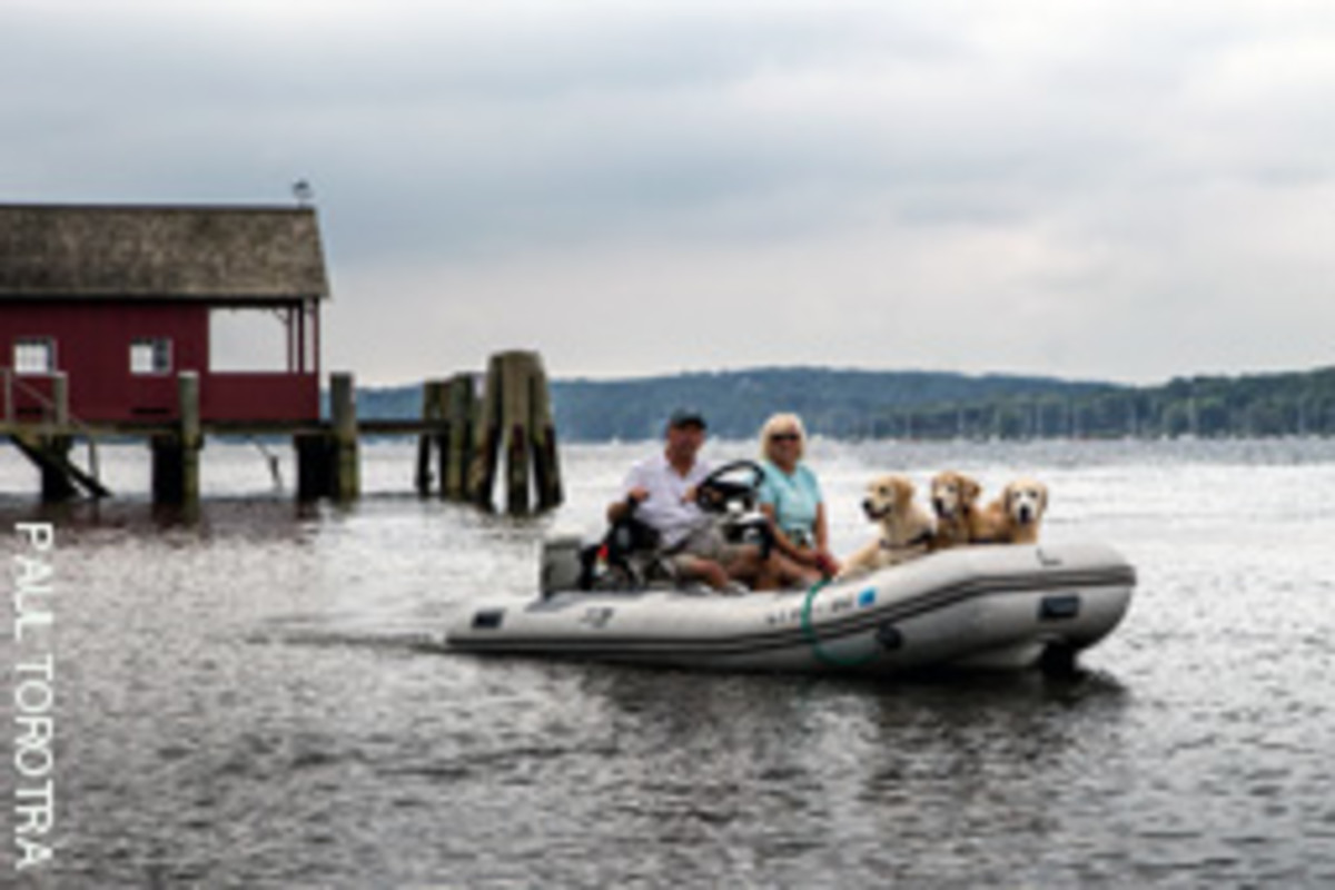 The Minards both enjoy having the retrievers on board, an important factor for anyone considering cruising with dogs.