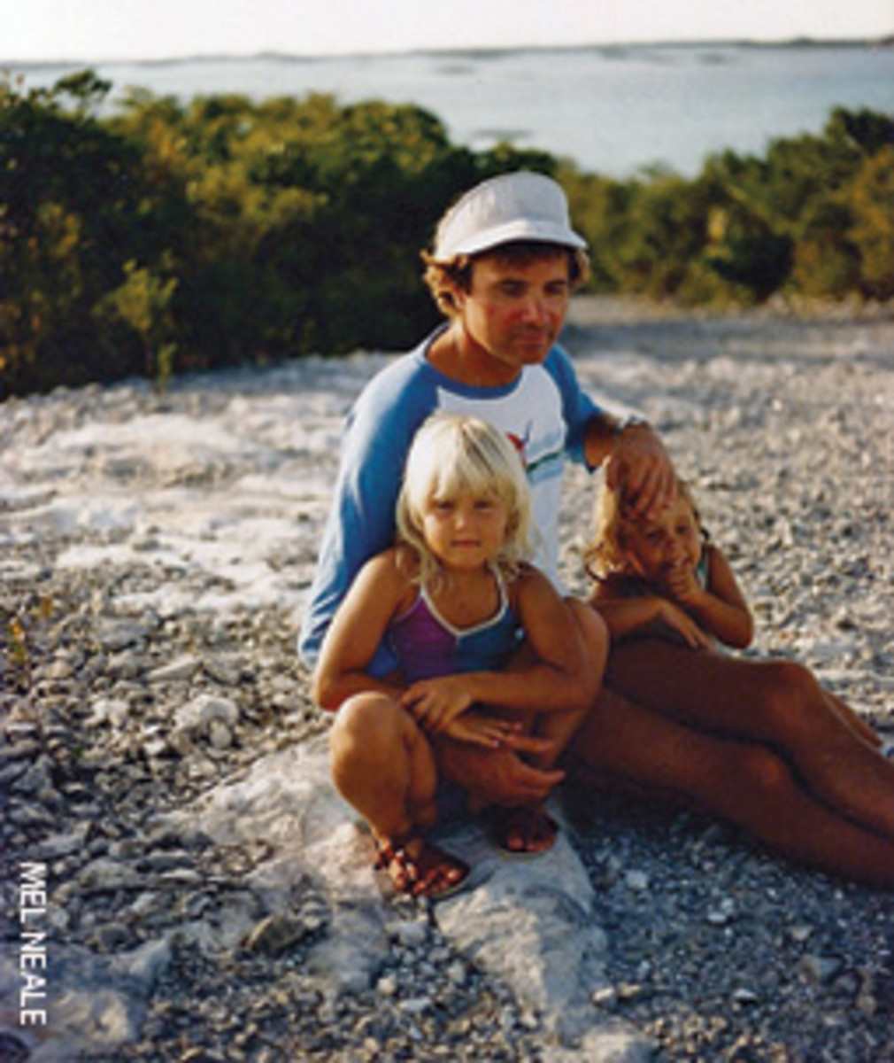 Melanie and Carolyn with their father, Tom Neale, in the Exumas, Bahamas, in 1985.