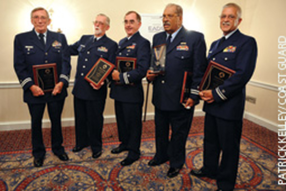 Five Coast Guard Auxiliarists were given the AFRAS Silver Medal for saving a stricken man aboard a runaway jonboat.