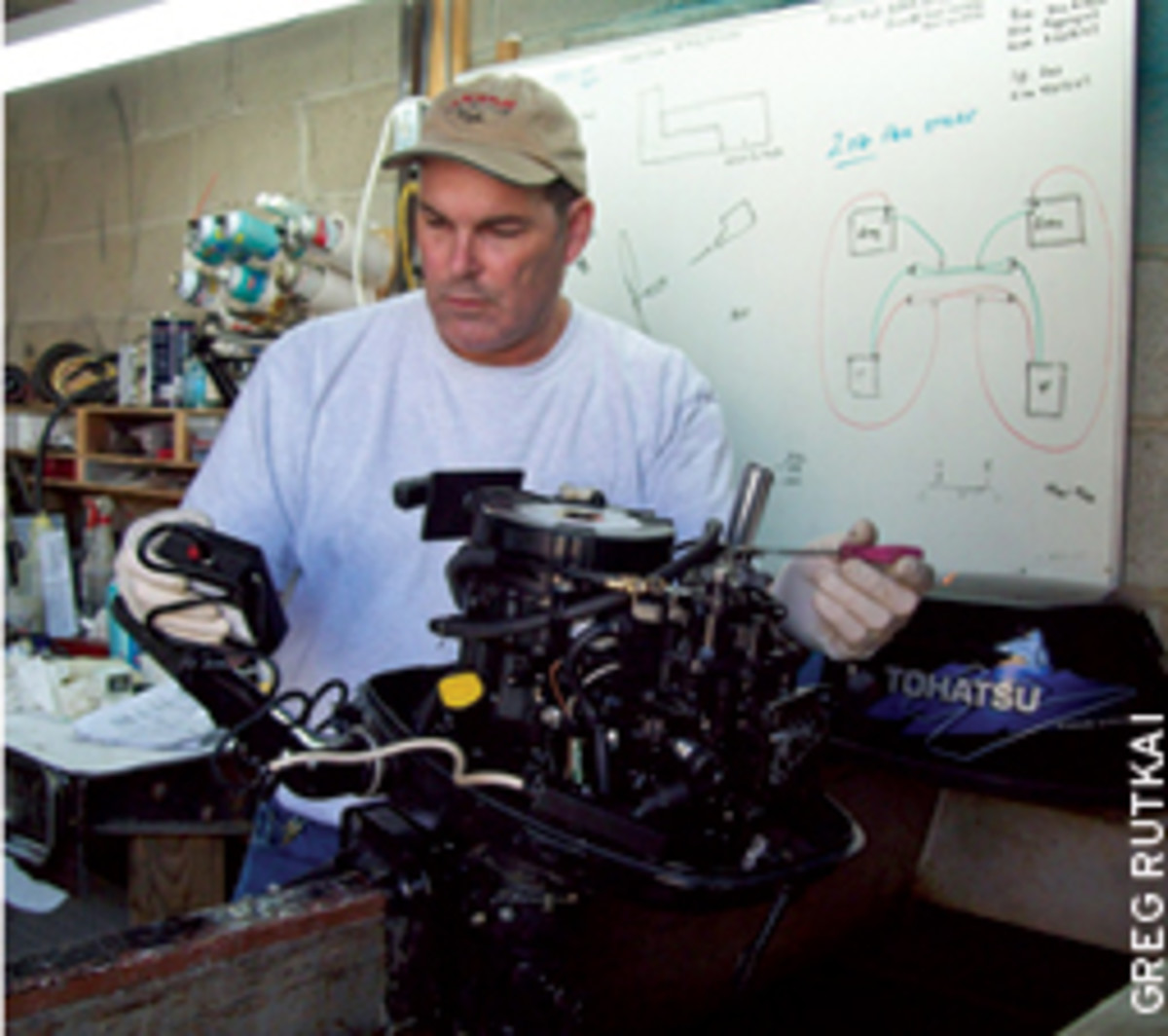 Chuck Holm gave the Bay Tripper's Tohatsu 4-stroke some TLC and showed him how to care for it.