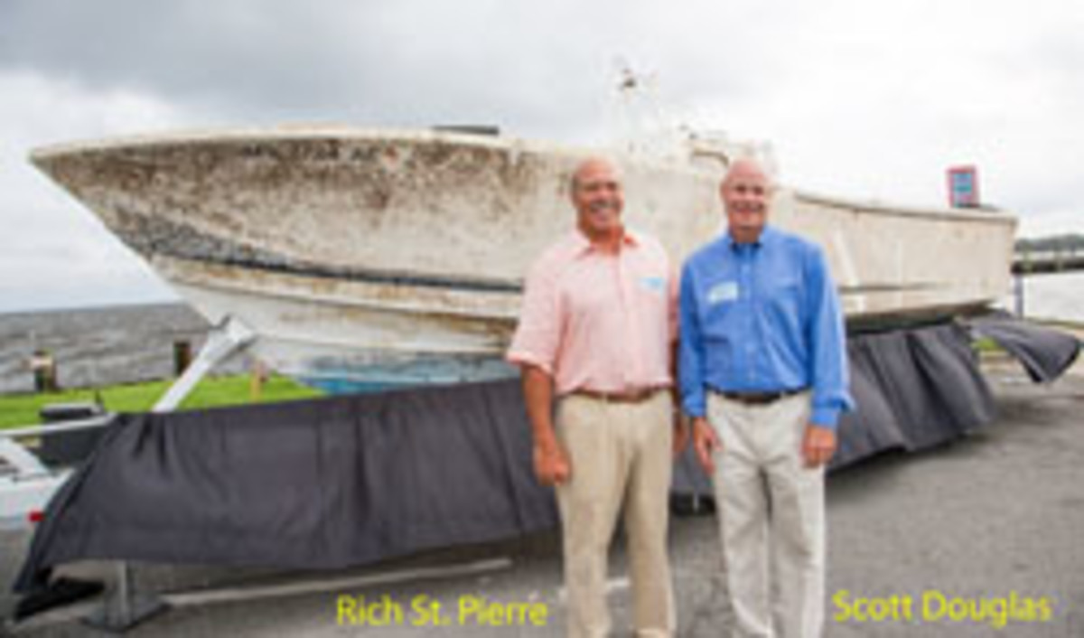 Queen Bee's owner, Scott Douglas (right), and his brother-in-law, Rich St. Pierre, were recently reunited with the boat they were knocked out of.