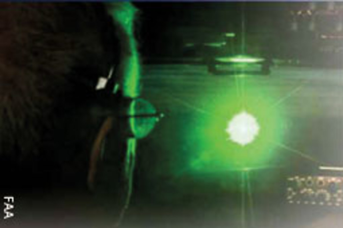 This images shows a green laser as seen by a pilot.