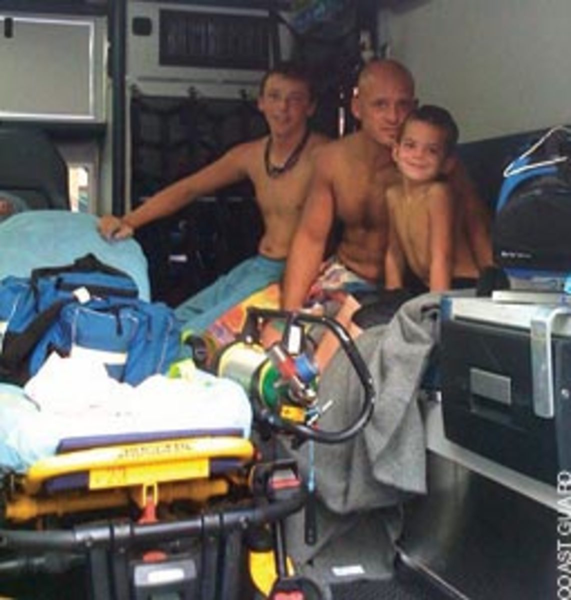 Wearing PFDs and staying together near the boat helped save the anglers. Shown here are (from left) Tyler Willimon, Jody Gouge and his son Xander.