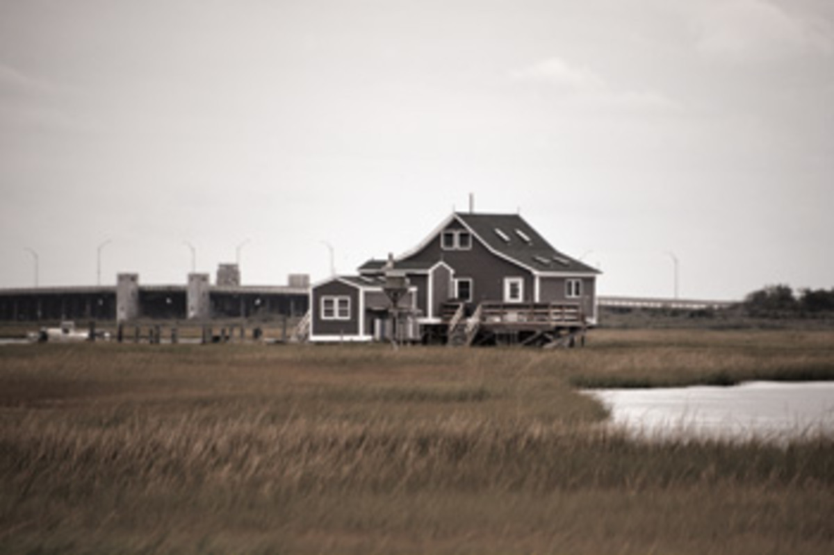 Bay houses are vulnerable to storms, so they are subject to government regulation over pollution and other concerns.