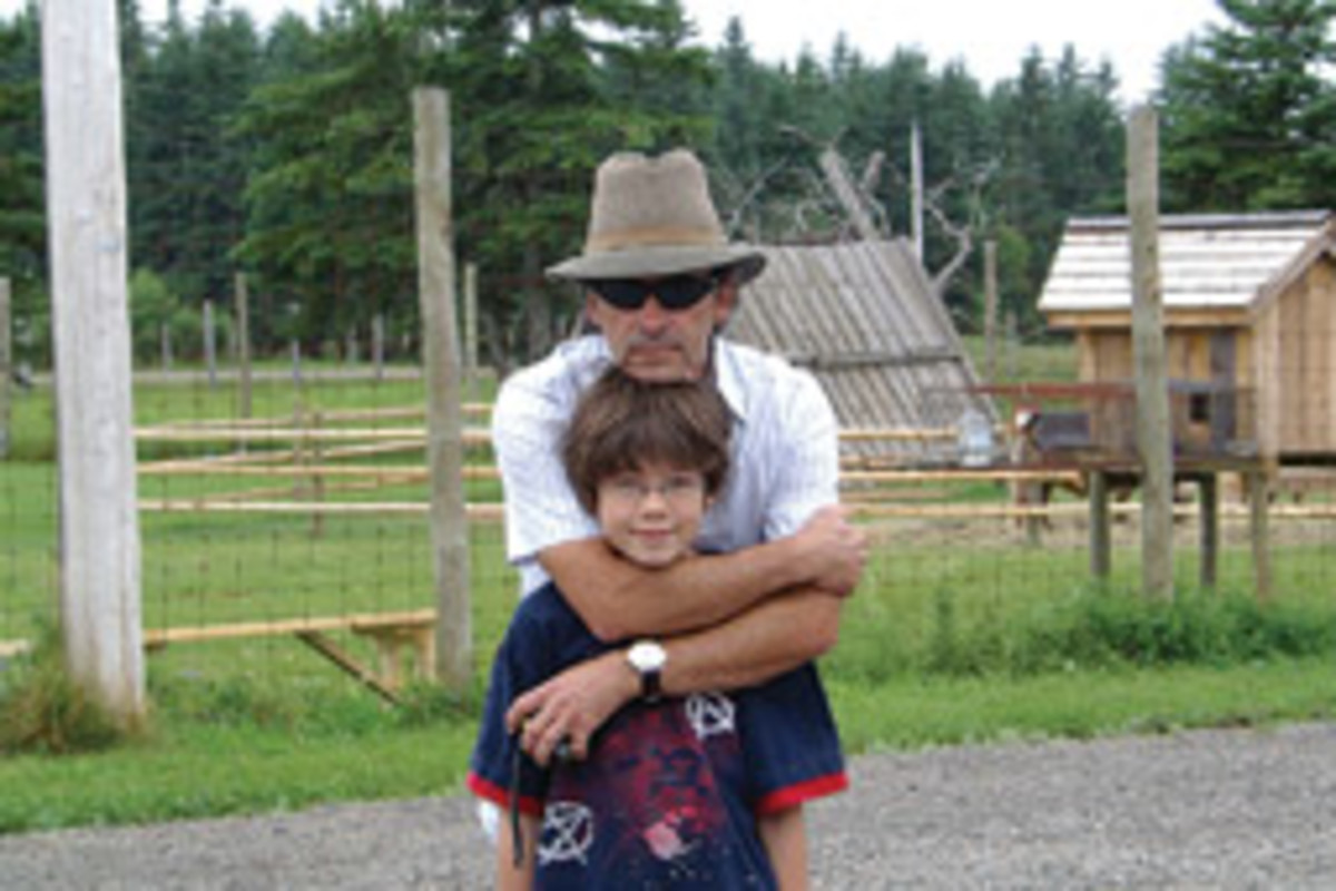 Michel Servant - with 13-year-old son Lucas - is willing to swap his buffalo ranch in Canada for a Nordhavn trawler or other bluewater passagemaker.