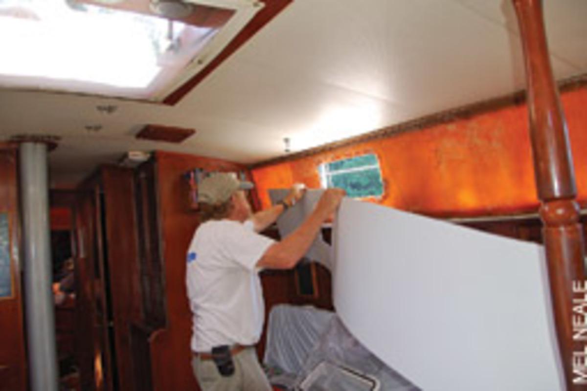 Komatex replaced the old teak veneer around the portholes.