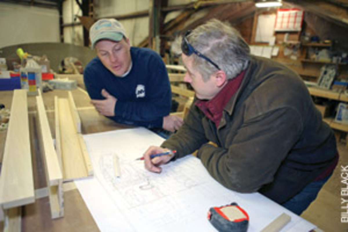 Keith Herridge (left), lead mechanic at custom builder Lyman-Morse, discusses a design with project manager Michael Faller.