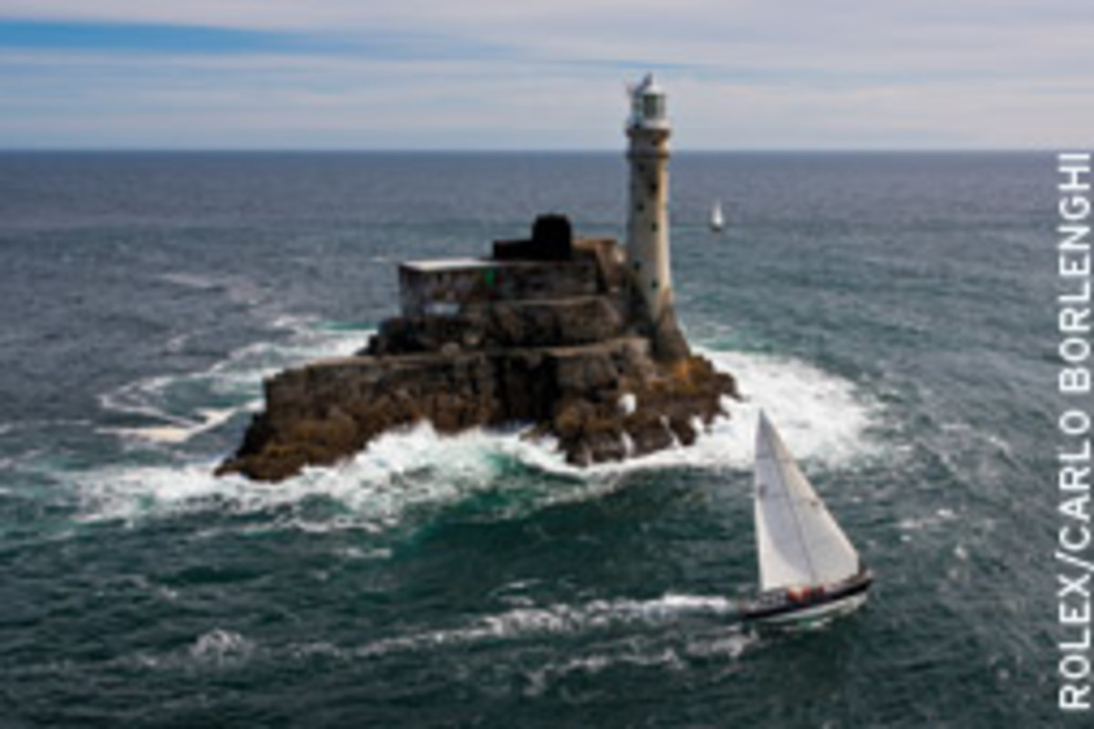 Potts' sailboat rounds Fastnet Rock with a crew of fathers and sons in last year's Rolex Fastnet Race.