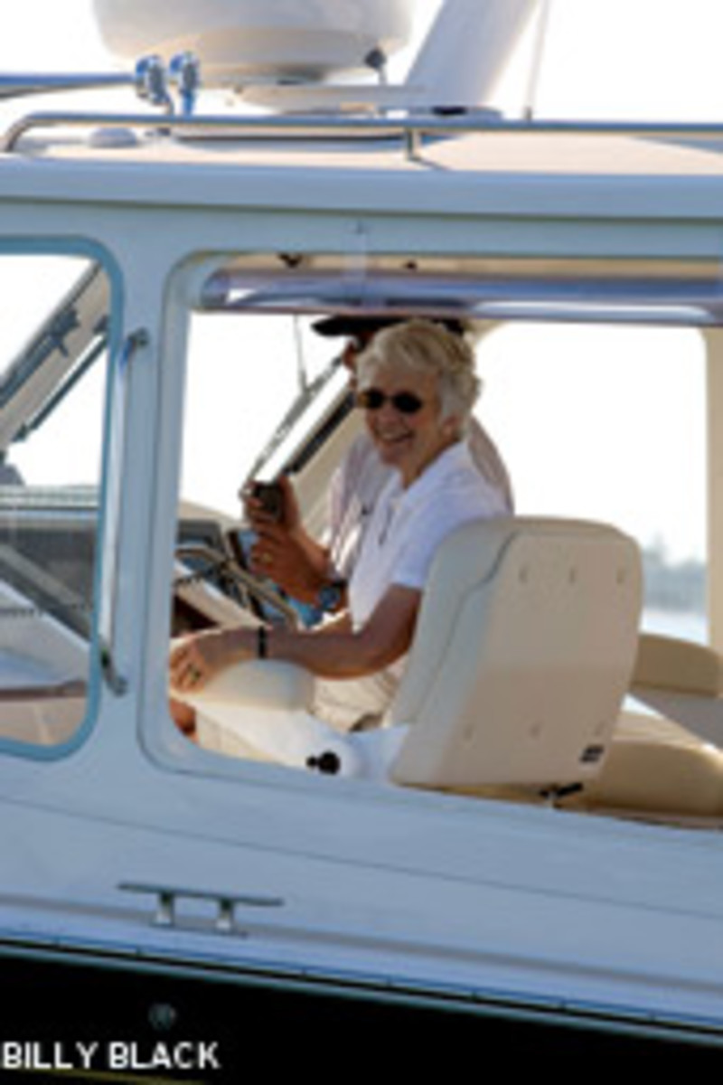Mary Johnstone is shown in an MJM powerboat. The initials MJM Yachts stands for 'Mary Johnstone's Motorboat.'