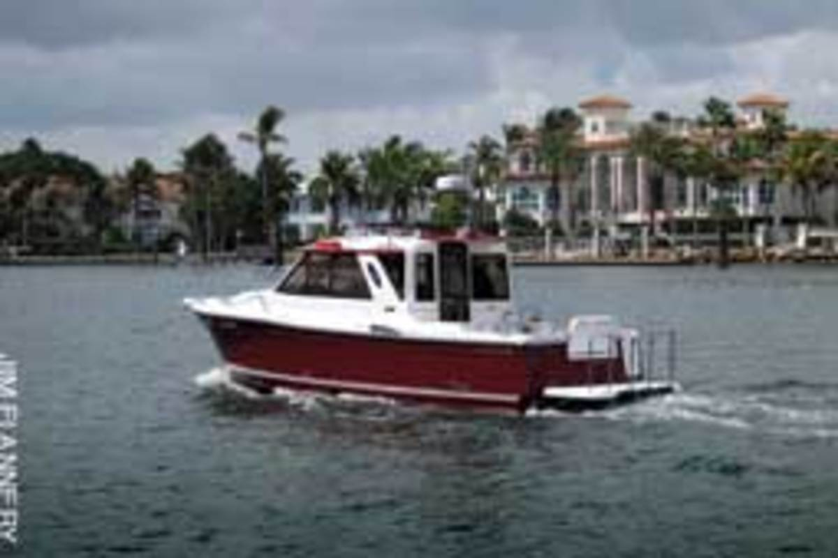 The trailerable Cutwater 28 is set up for economical cruising, with its single diesel power, port-side galley and convertible double berth in the cabin.