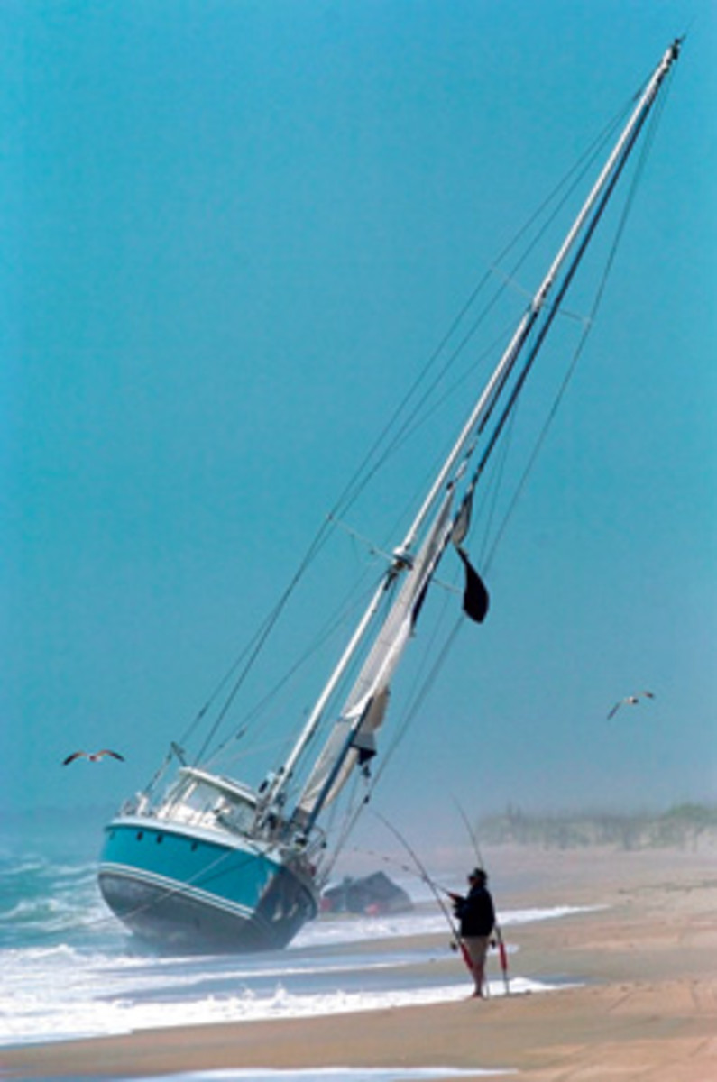 The three people aboard Illusion were rescued, and the aluminum-hulled 67-footer washed ashore at Fort Fisher, N.C.