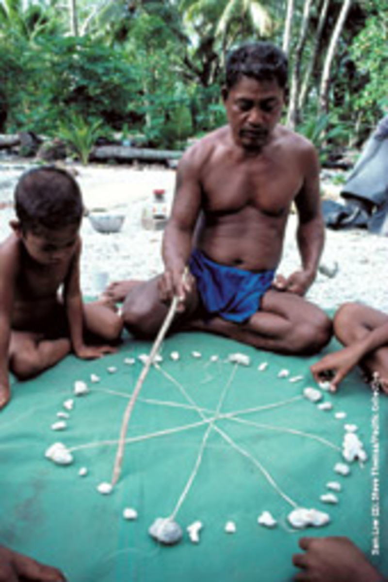 Piailug, with son, conducts a navigation class in 1983.