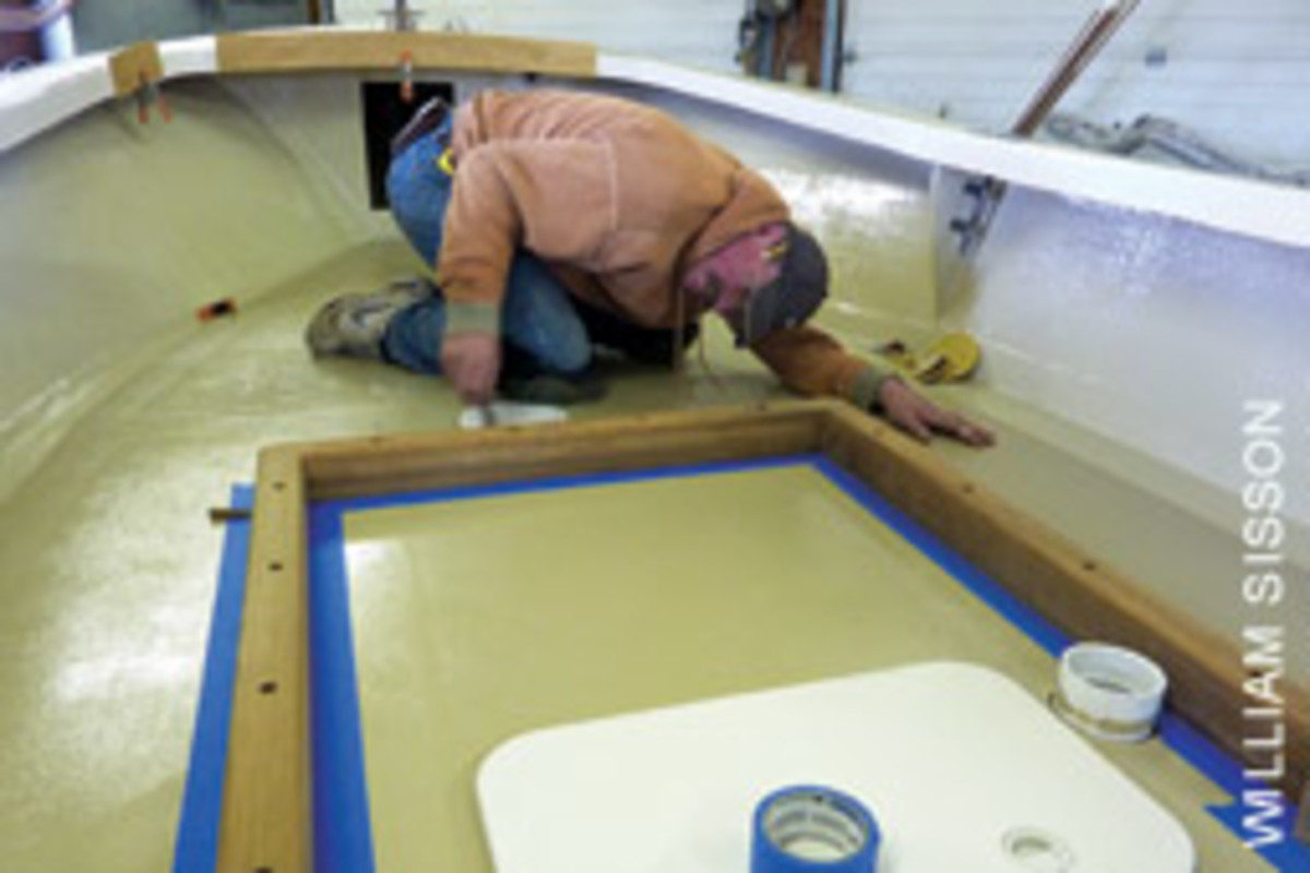 Koller eyes up the teak platform he made for raising the center console.