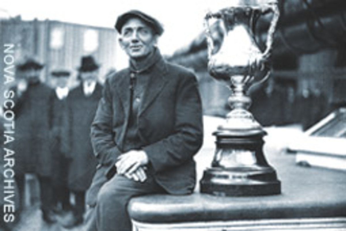 Bluenose captain Angus Walters, with the International Fisherman's Trophy.