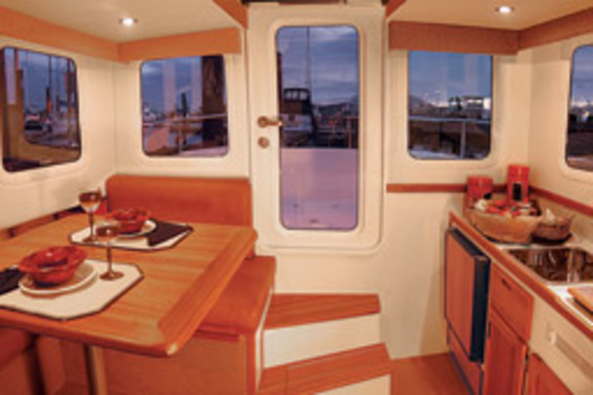 The nearly full-beam pilothouse contains the galley/saloon and the helm station. The dinette converts to a double berth, and the V-berth and wet head are below.