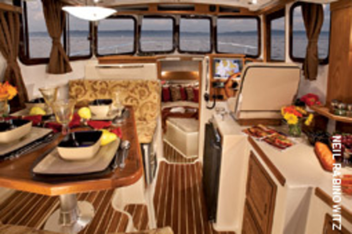 The Ranger 29 is set up for simple cruising, with a pilothouse helm station and galley/saloon, forward stateroom, and easy access to the battery bank and inverter.