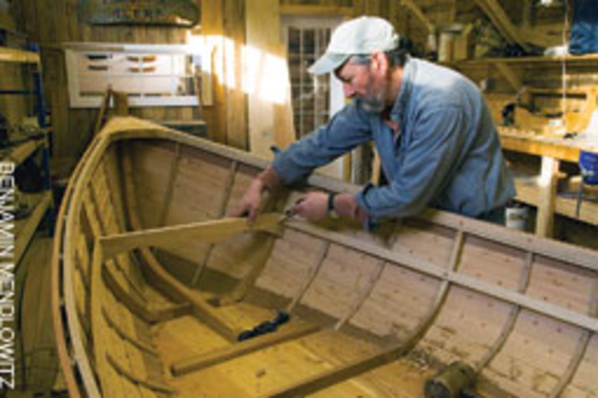Fitting a crossbeam on a Darrow Pond skiff at Boothbay Harbor Shipyard