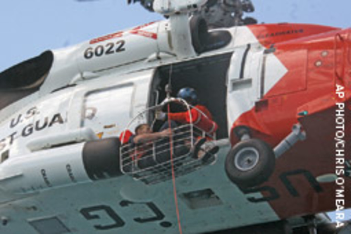 Schuyler is hoisted to the Coast Guard rescue helicopter.